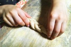 child-rolling-pretzel-dough