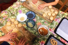 children-making-dumpling-meals-with-large-workstation