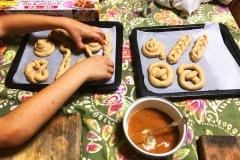 children-making-rolled-dough-baked-goods