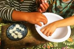 students-forming-dumplings-in-white-bowl