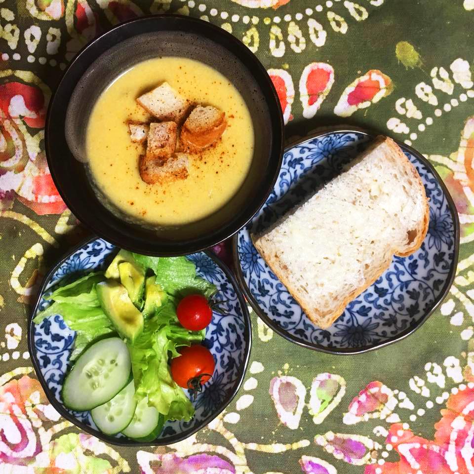 3 courses soup, salad, bread on decorative plates