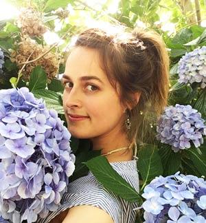 english teacher emma swank in a lilac bush
