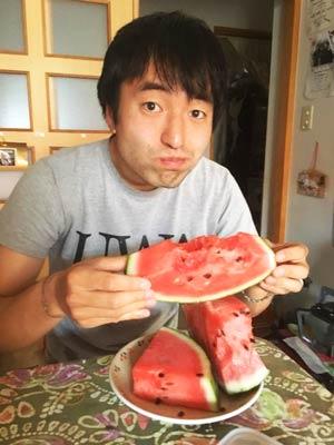 English Teacher Masafumi Onishi with a mouthful of juicy watermelon